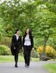 Businesswomen Walking in Park