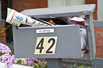 Overstuffed Broken Mail Box
