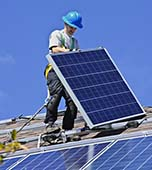 Professional Solar Panel Installer with Safety Harness