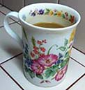 Author's Flowered Porcelain Coffee Mug Received as a Re-gift