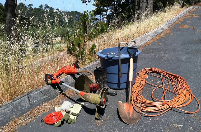 Author's Weed Whacking Equipment (weed whackers, extra line, extension cords, boots, gloves, sunglasses, dust mask, ear plugs, plastic tub, tongs, shovel