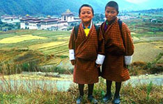 Bhutanese Kids with Fields and City in Background