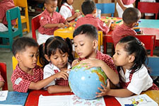 Kindergarten Kids with Globe