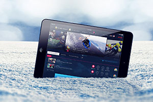 2014 Sochi Olympics - NBC Streaming Live on Computer Tablet in Snow - Photo: mexrix / Shutterstock