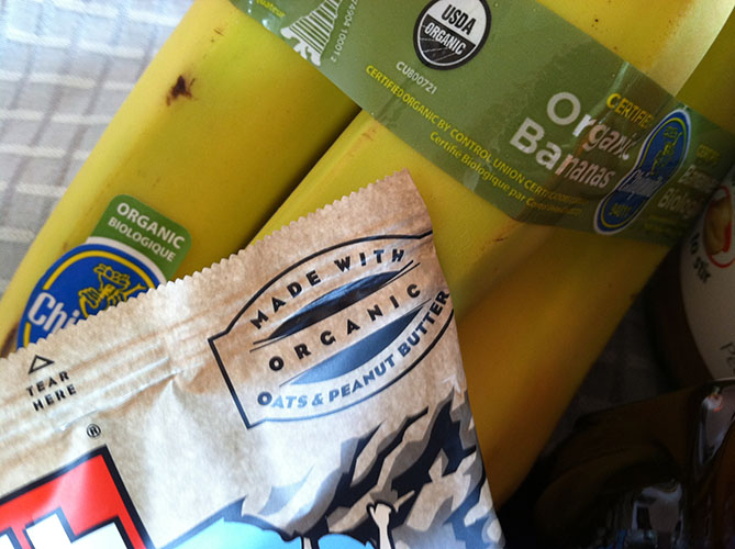 Clif Bar Made with Organic Ingredients and Bunch of Organic Bananas with USDA Seal