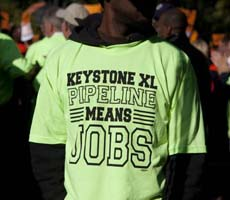 Green T-shirt that says Keystone XL Pipeline Means Jobs - Photo: Dallas News