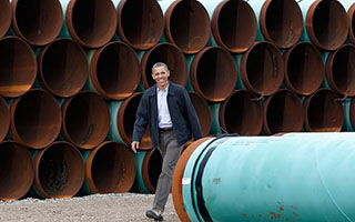 President Barack Obama Walking at TransCanada Pipe Yard in Cushing, OK in March, 2012 - Photo: Pablo Martinez Monsivais/AP