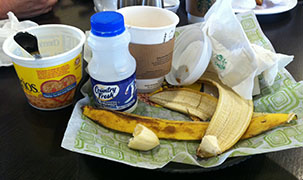 Breakfast Waste at the Hotel - Cereal, Milk, Banana, and Coffee