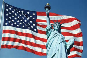 American Flag Flying with Statue of Liberty
