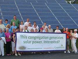 Solar Panels with Congregation Members Holding Banner - Photo: Green Faith
