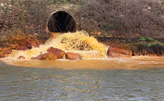 Pipe Dumping Pollution into River