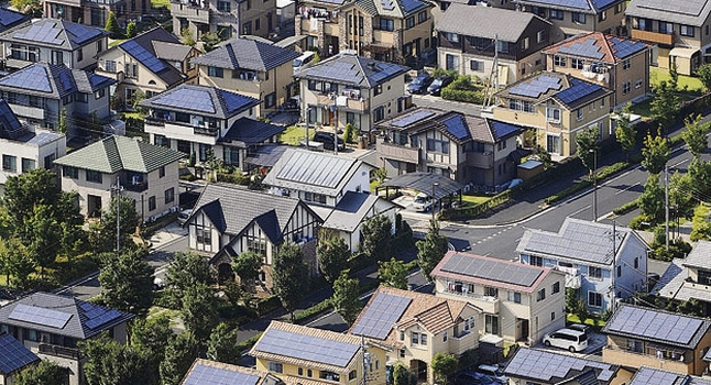 Homes with Rooftop Solar in Japan - Photo: Kyodo / AP /  PA