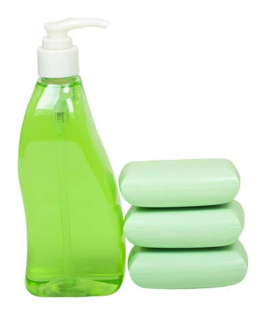 Liquid Soap Dispenser and Stack of Bar Soap