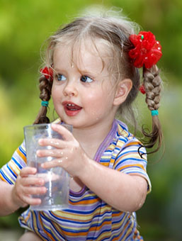 Little Girl Drinking a Glass of Water