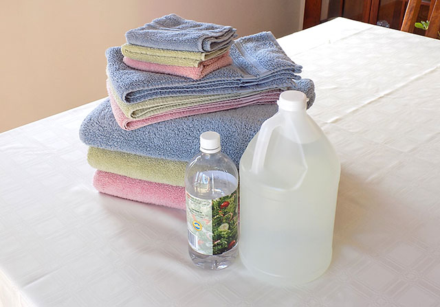 Freshly Washed Towels with Bottles of White Distilled Vinegar