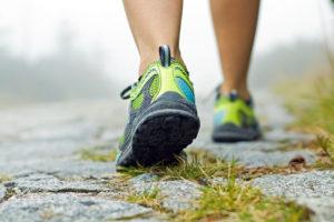 Woman Wearing Tennis Shoes Walking on a Trail