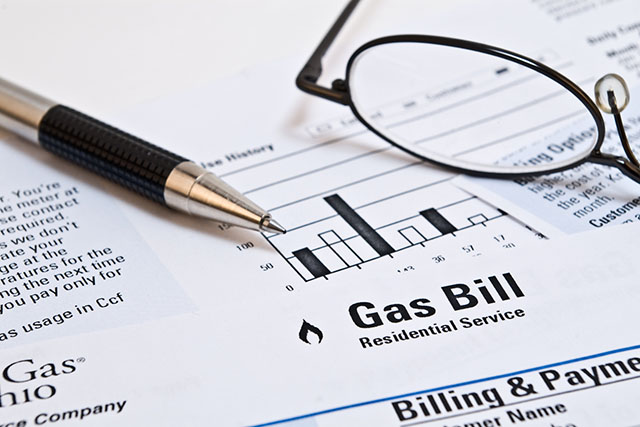 Natural Gas Bill with Pen and Eyeglasses