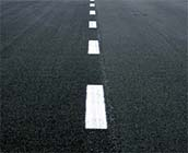 Asphalt Road with Dashed White Line