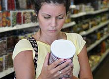 Woman Reading Food Label - Photo: U.S. FDA