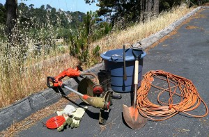 Author's Weed Whacking Equipment (weed whackers, extra line, extension cords, boots, gloves, sunglasses, dust mask, ear plugs, plastic tub, tongs, shovel)