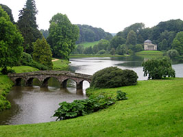 Stourhead Landscape Garden, Wiltshire, England with Rolling Lawns, Trees, Lake, and Bridge