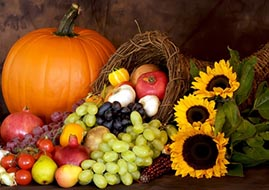 Thanksgiving Cornucopia with Fruit, Pumpkin, and Sunflowers