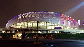 Bolshoy Ice Dome Showing Canadian Flag with Colored LEDs - Photo: cotsonika