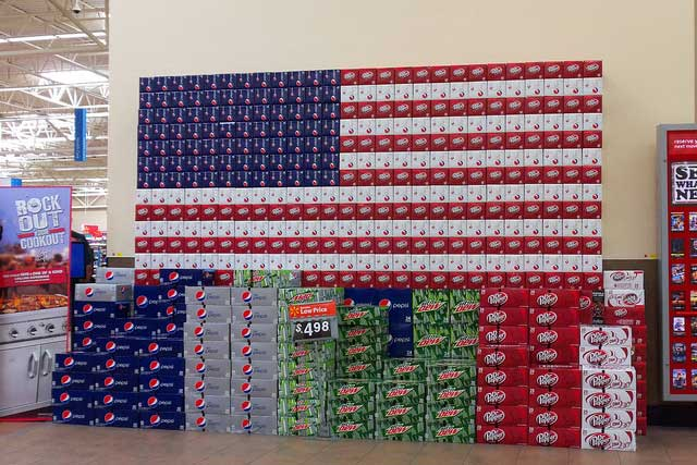 Cases of Soda Cans Stacked to Resemble American Flag - Photo: Daniel Oines