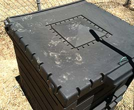 Unlikely Composter's Compost Bin with Critter Paw Prints on Top