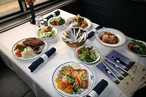 Amtrak Coast Starlight Dining Car Table with Dinner Selections - Photo: Carl Morrison