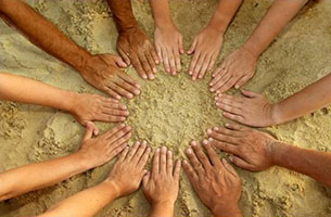 Hands Forming a Circle over Sand - Collaboration