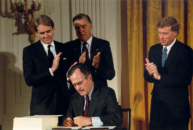 William Reilly and Others Watch President H. W. Bush Sign Clean Air Act Amendments on November 11, 1990 - Photo: White House / Carol T. Powers