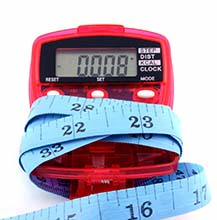 Tape Measure Wrapped Around Pedometer