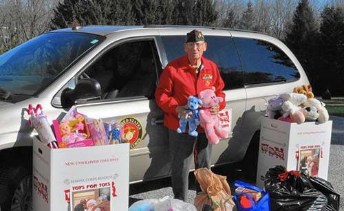 Former Marine Harry Smith with Toys for Tots Collection Boxes and Toys - Photo: Pat van den Beemt