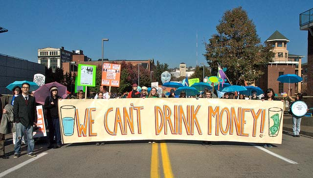 "People Carrying ""We Cant' Drink Money"" Banner during Protest March in Pittsburgh, PA - Photo: Marcellus Protest"