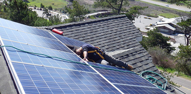 Rooftop Solar Panels on Home of the Unlikely Environmentalist - Danny from A.M. Sun Solar Finishing Installation