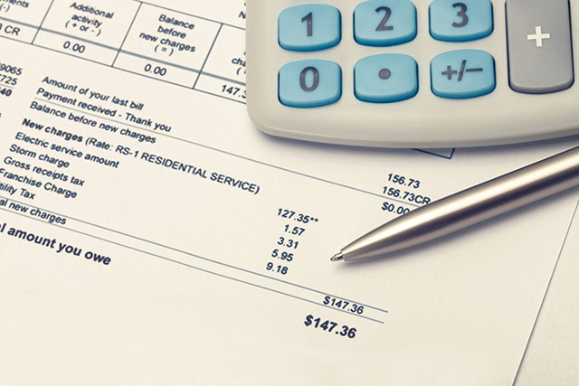 Electric Bill with Pen and Calculator - Photo Credit iStock/Niyazz