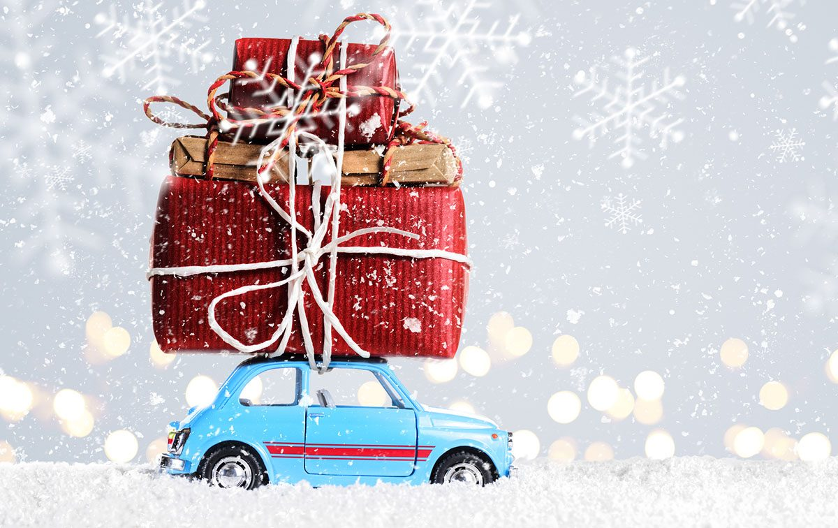 Little Blue Car Overloaded with Christmas Gifts on Top