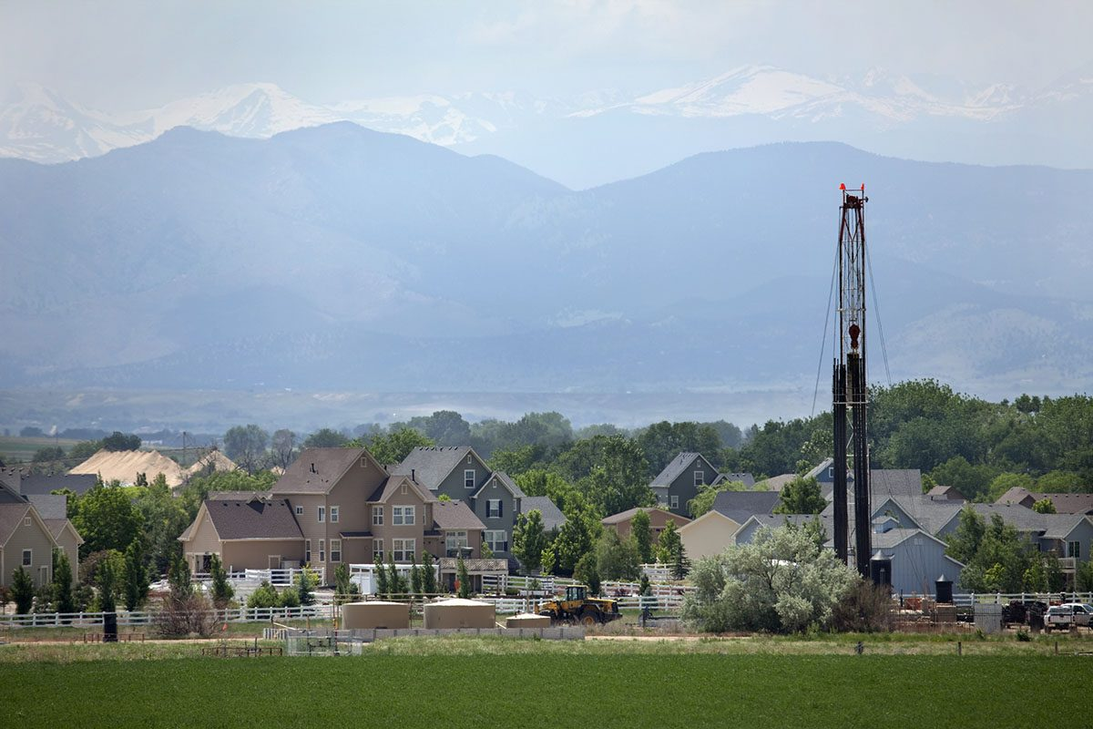 Natural Gas Fracking Rig and Storage Tanks Adjacent to Neighborhood in Colorado