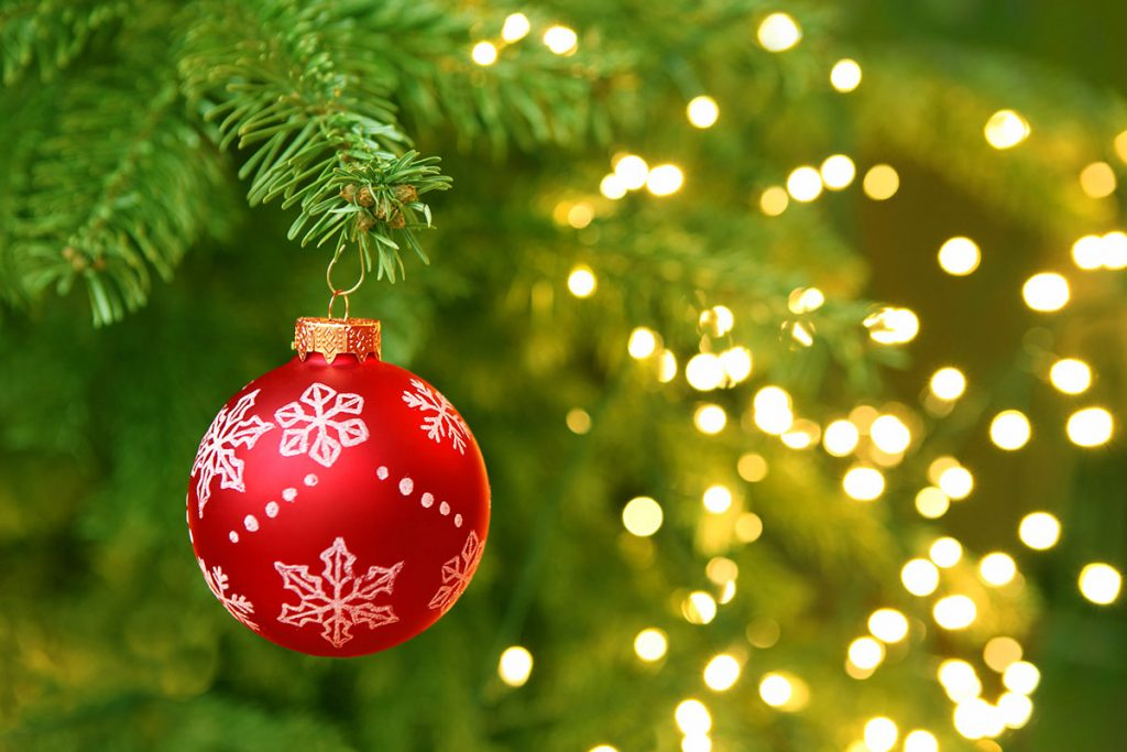 Red Christmas Ball Hanging On Christmas Tree With Blur