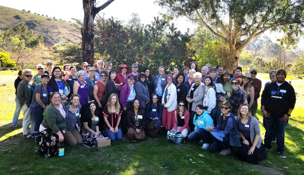 Chumash Kitchen Group Photo in Front of a Toyon