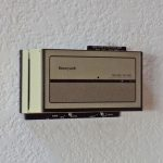 Circa 1980s Programmable Thermostat Mounted on Wall
