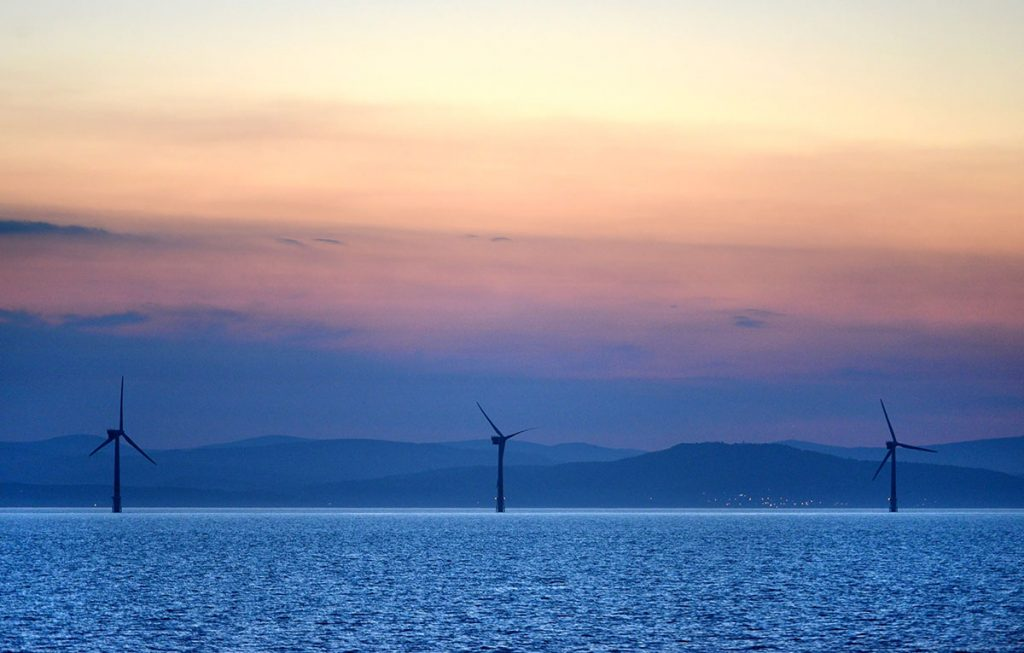 Three Wind Turbines at Sunset off the Irish Coast