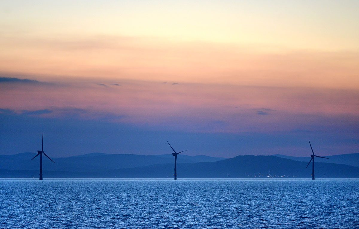 Three Wind Turbines at Sunset off the Irish Coast