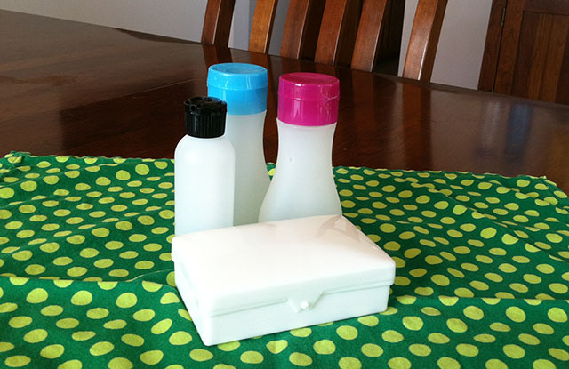 Four Reusable Travel-Size Toiletry Containers