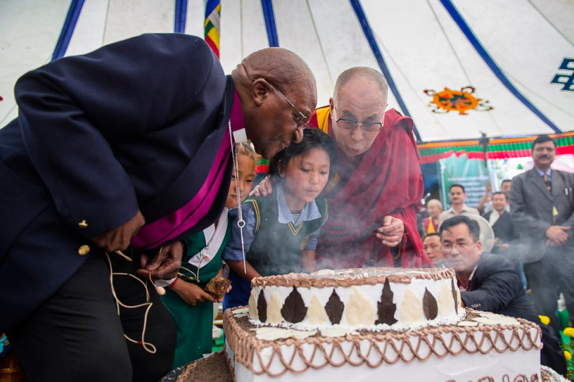 Dalai Lama and Desmond Tutu Blowing Out Candles on Birthday Cake