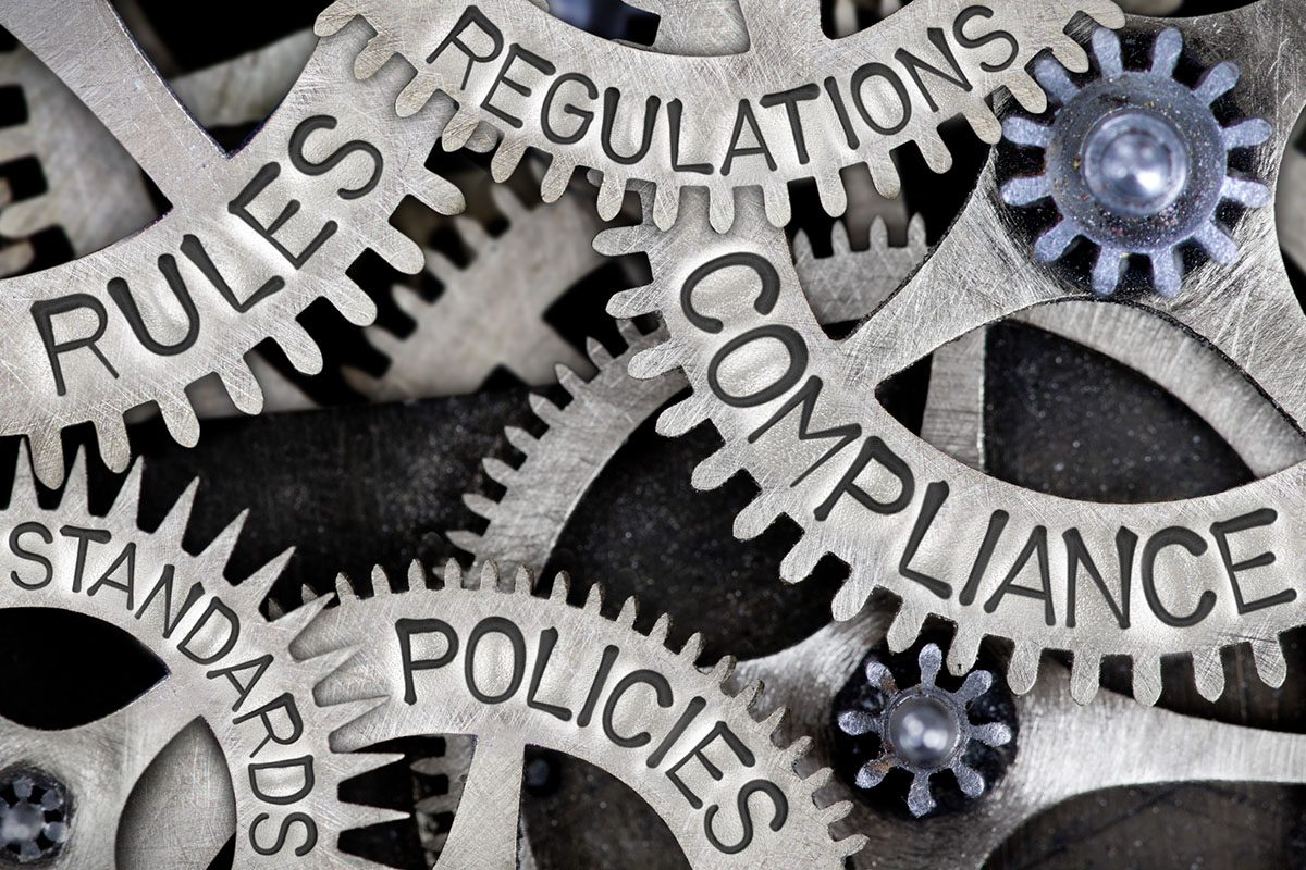 Meshed Gears that Say Rules, Regulations, Compliance, Policies, and Standards