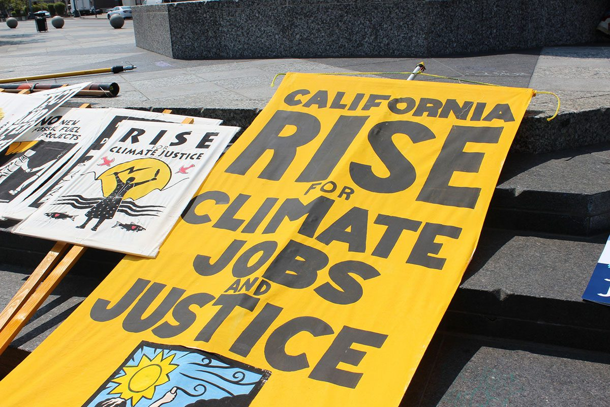 Rise for Climate Signs Ready for San Francisco March on September 8, 2018
