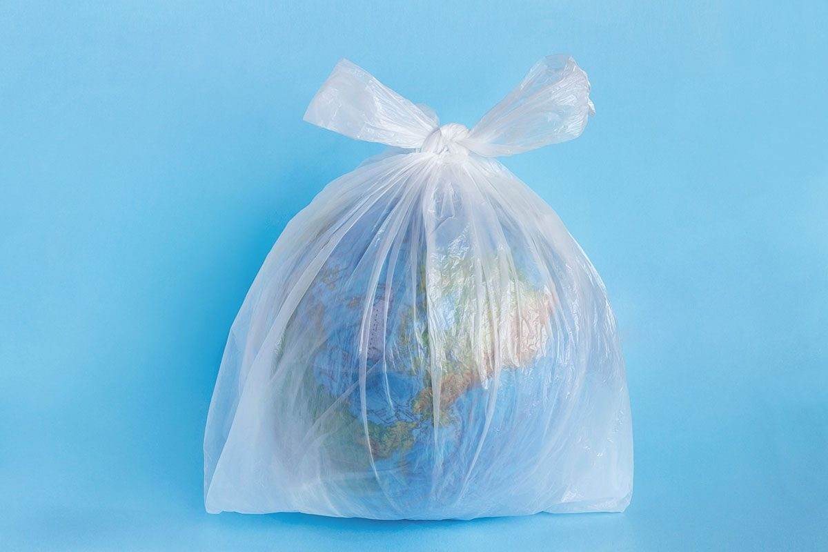 Earth Globe Inside a Single-Use Plastic Bag