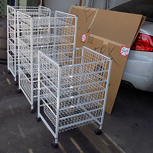 White Multi-Tier Wire Storage Baskets on Wheels in Garage